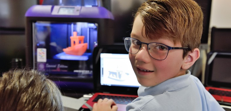 Student standing infront of 3D Printer