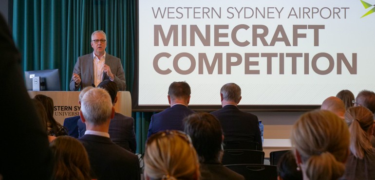 Mark Scott is giving a speech at the Western Minecraft Challenge