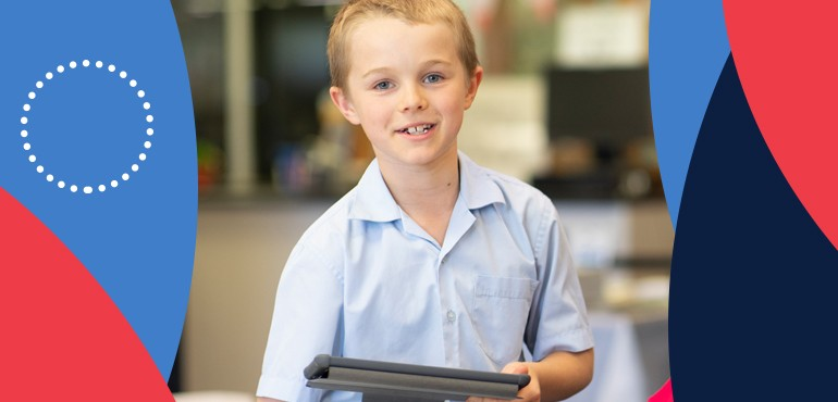 student holding an iPad